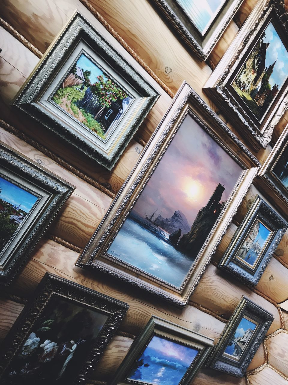 indoors, no people, picture frame, reflection, frame, window, high angle view, photography themes, glass - material, nature, technology, wood - material, communication, group, built structure, architecture, table, day