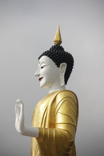 Statue of buddha against white background