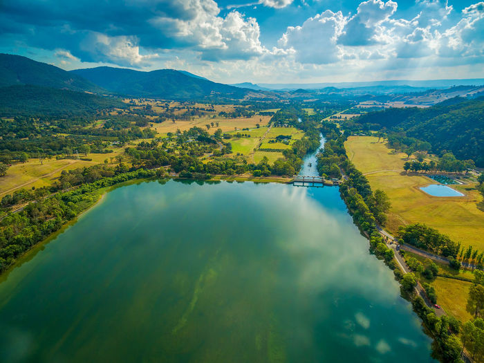 Aerial landscape of beautiful lake on bright summer day Australia Australian Landscape Beautiful Drone  Panorama Panoramic Recreation  Aerial View Agriculture Beauty In Nature Cloud - Sky Countryside Day Drone Photography Eildon Eildon Dam Green Color Idyllic Lake Lake Eildon Landscape Mountain Nature No People Outdoors Recreational Pursuit Scenics Sky Tranquil Scene Tranquility Tree Water