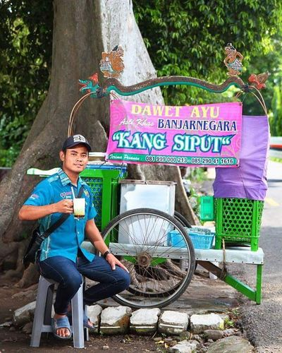 My shot of Muhazir. Hazir is a street hawker at Yogyakarta, Indonesia. The Magelang native claims his beverage, the popular es dawet ayu is one of the best in town. The perfect way to prove his words is to taste it. He can be found at Jalan Kusbini near Balai Yasa railway workshop. Portrait Portrait_shots Hawker Streethawker