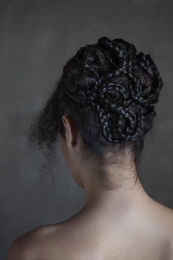 Rear View Of A Woman With Hairstyle