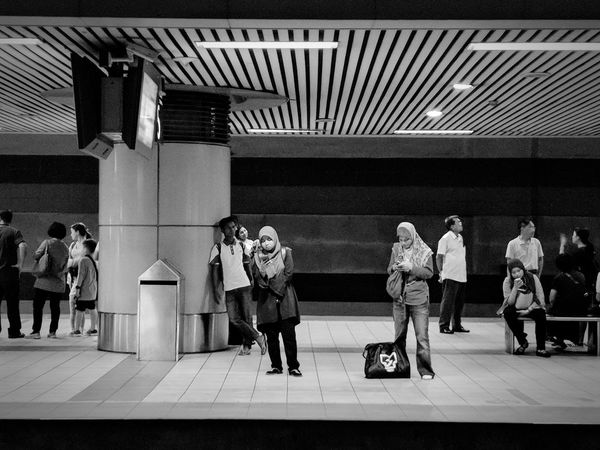 """""""My optimistic mind tells me loudly the wait is always worth it. The other voice silences itself"""" Waiting waiting game People Watching Street Photography Urban Photography Men Full Length Women Student Subway Platform Subway Train Commuter Train Passenger Train Public Transportation Railroad Station The Traveler - 2018 EyeEm Awards The Street Photographer - 2018 EyeEm Awards"""
