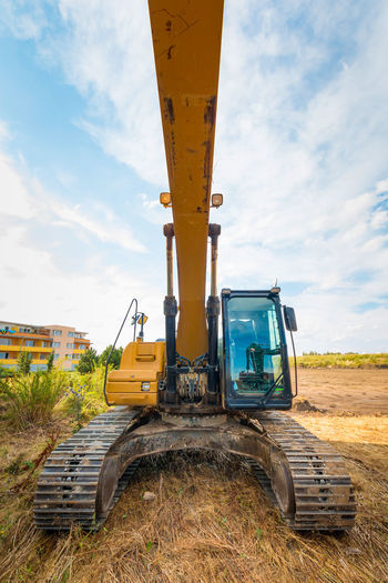 Construction Machinery Construction Site Construction Vehicle Day Earth Mover Industrial Equipment Industry Land Vehicle Machinery Mode Of Transport No People Outdoors Road Sky Transportation