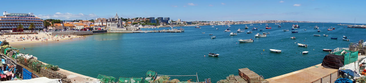 Panoramic view of Cascais, Portugal Water Nautical Vessel City Architecture Building Exterior Travel Destinations Built Structure Transportation High Angle View Mode Of Transportation Travel Sky Harbor Sea Nature Cityscape Building Urban Skyline Day Passenger Craft Outdoors No People Sailboat Cascais Panoramic View