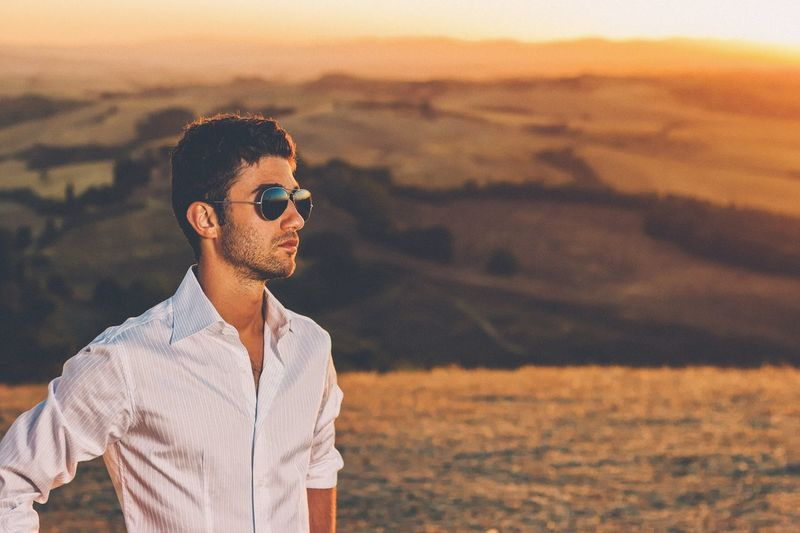 Contemplating Sunglasses Outdoors Men Young Adult Landscape Lifestyles Nature One Person Only Men Sunset Sand Day One Man Only Adults Only Adult People Faded Sunset_collection Power In Nature Model Copy Space Vintage Vintage Photo Confidence