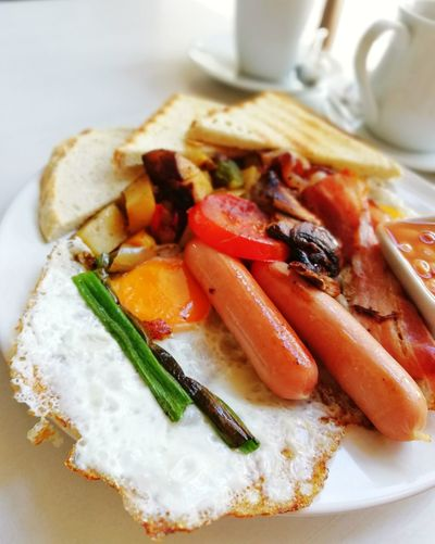 Delicious English breakfast with grilled sausage, fried eggs and vegetables prepared for eating Breakfast Morning Backgrounds Sausage Egg English Breakfast Morning Rituals Delicious Tasty Healthy Eating Healthy Food Vegetables Enjoying Life Enjoying A Meal Enjoy Served Colorful Plate SLICE Close-up Food And Drink Toasted Bread Served Fried Fried Egg English Breakfast Omelet Prepared Food Toaster Serving Size