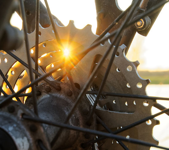 Detail view of a bicycle in a backlit situation, look through the bicycle spokes, sunbeams shine through the gears, signs of wear show the use on a bicycle tour Cycle Sunlight Backlit Bicycle Chain Bicycle Gears Bicycle Tour Bicycle Travel Bike Chain Bike Details Bike Gears Bike Riding Biking Outdoor Biking Outdoors Chain And Gears Close-up Day Gears Metal No People Outdoors Sport Sun Sun Light Sunbeams Sunlight