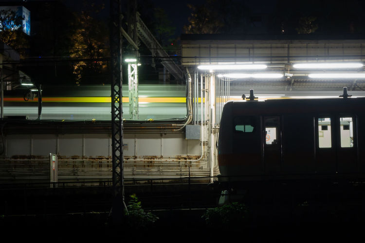 Train at railroad station at night