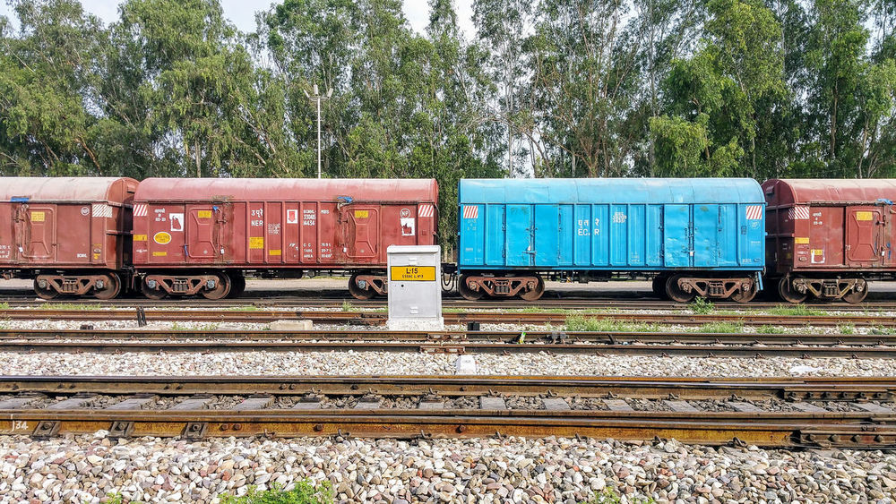 The wagons and the box Wagons Railroad Patiala India Outdoors No People Cargo Container Public Transportation Sky Tree