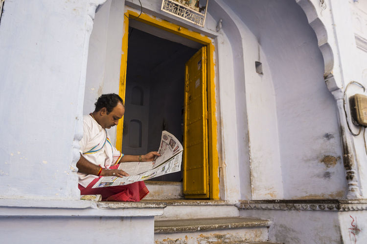 snapshot of man reading newpaper on arch door in Pushkar, India Arch Architecture Built Structure Candid India Travel Indianstories Indiapictures Leisure Activity Life Lifestyles Photowalk Pushkar Snap Photo Snapshot Streetlife Streetshot Traditional Clothing Traditional Culture Travel Photography