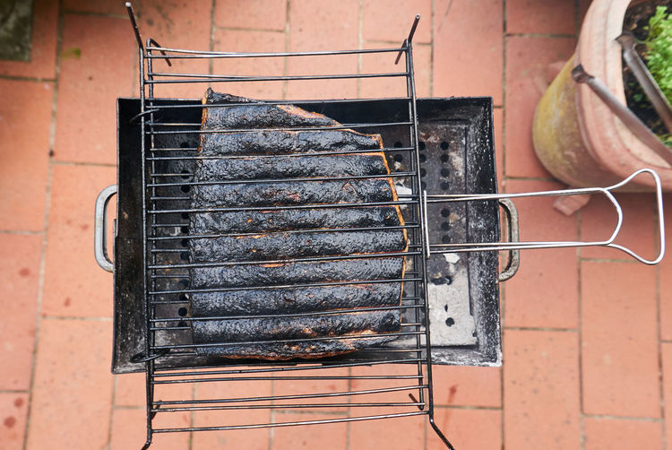 Directly Above Shot Of Meat On Barbecue Grill