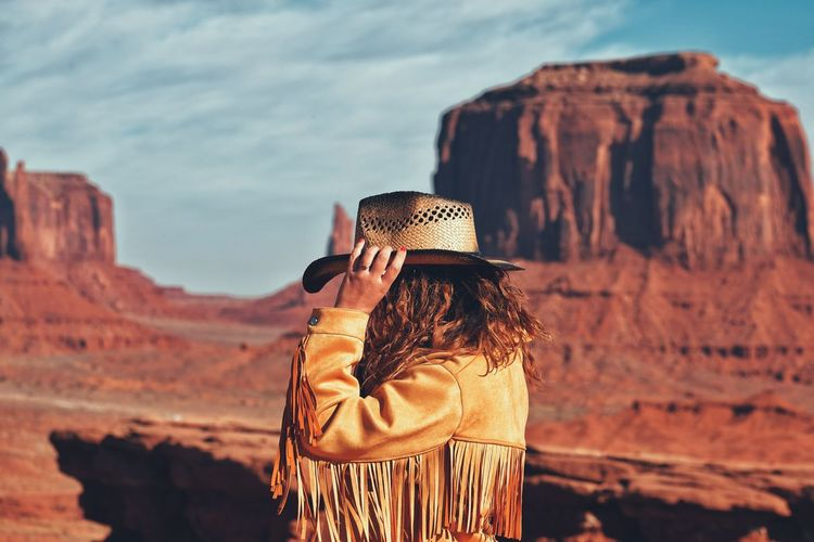 Woman standing against rock formation