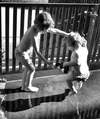 Just Playing Around Shadow Waterdrops Drops Drops Of Water Reflection Morning Moments Childhood Child Sisters Sis Dancing In The Rain Dance Dance Photography Children The Moment - 2014 EyeEm Awards The Street Photographer - 2014 EyeEm Awards Children Photography Just Playing