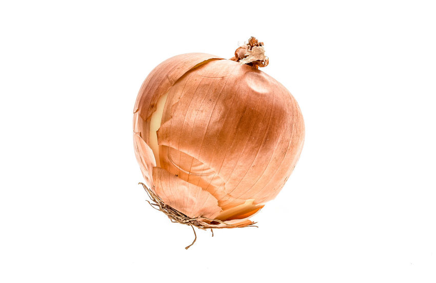 Organic Bio homegrown unpeeled yellow onion isolated on white background. Concept of homegrown organic food not being cosmetically perfect. Bio Eco Green Ecological Food Fresh Onion Freshness Healthy Eating Homegrown Onions Organic Organic Food Organic Gardening Raw Onion Studio Shot Unpeeled Vegetables
