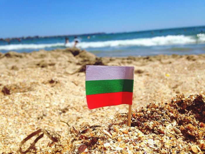 Bulgarian Flag At Beach Against Sky