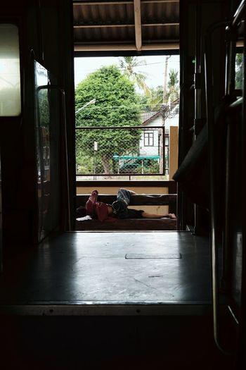 Person sleeping on railroad platform