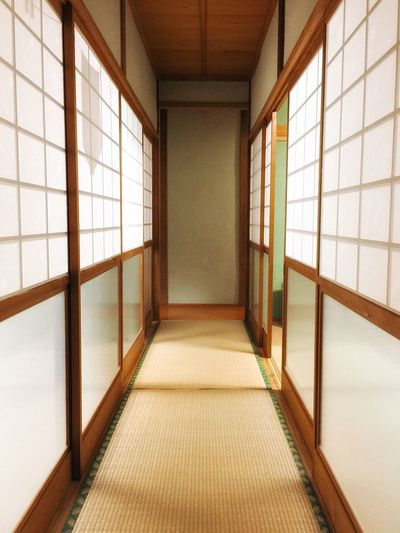 Empty corridor of building with japanese sliding door and tatami mat