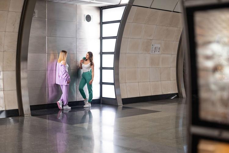 Women walking in corridor of building