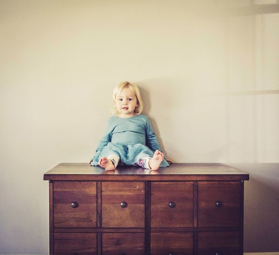 Portrait of smiling girl sitting at home