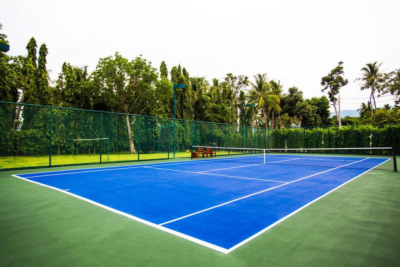 Outdoor blue ground tennis court