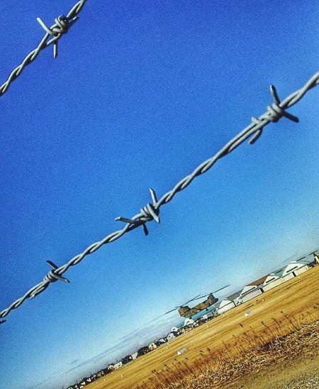 日本 Japan 自衛隊 Self-Defense Forces Clear Sky Blue Barbed Wire Metal Chainlink Fence Sky Close-up