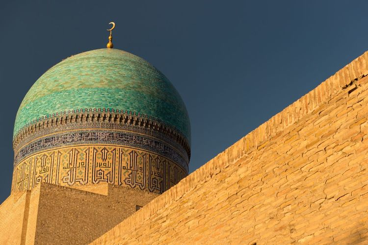 EyeEm Selects Bukhara Uzbekistan Tile Mosaic Architecture Dome Built Structure Religion Travel Destinations Low Angle View Building Exterior Place Of Worship Spirituality Day Outdoors No People