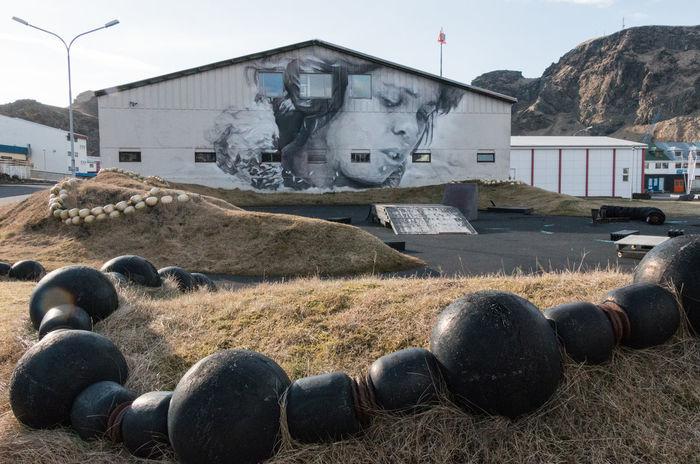 Graffiti Heimaey Iceland Skatepark Street Art/Graffiti Building Exterior Built Structure Land Nature No People Residential District Sky Street Art Transportation Village