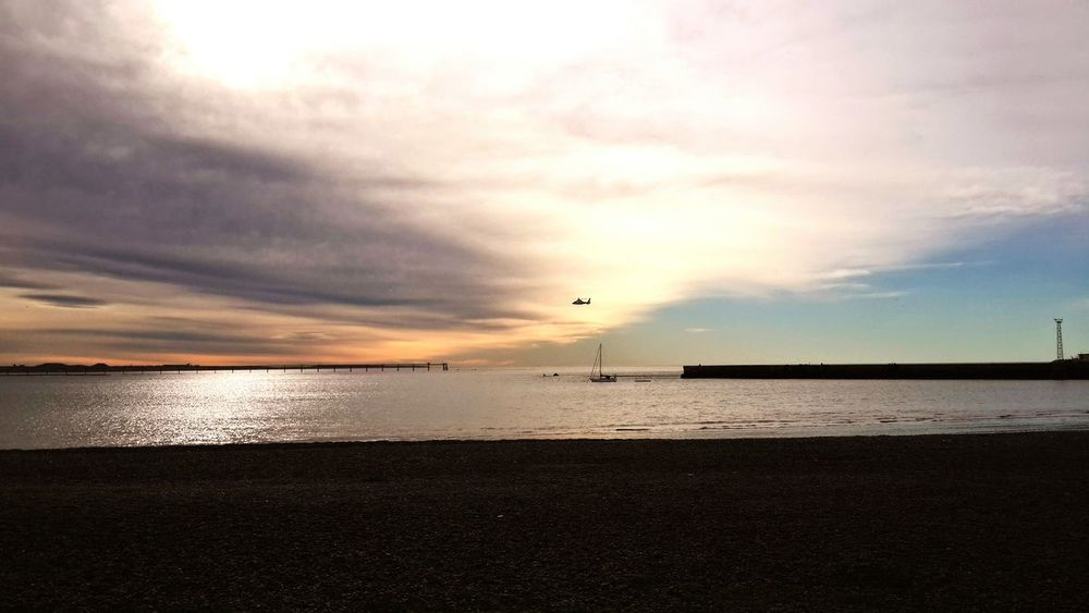Comodoro Rivadavia Chubut Sea Beach Cloud - Sky Water Beauty In Nature Nature Tranquility Scenics Horizon Over Water Outdoors Sun Sky Tranquil Scene Reflection No People Travel Destinations Sunlight Day Sunset hellicopter The Week On EyeEm