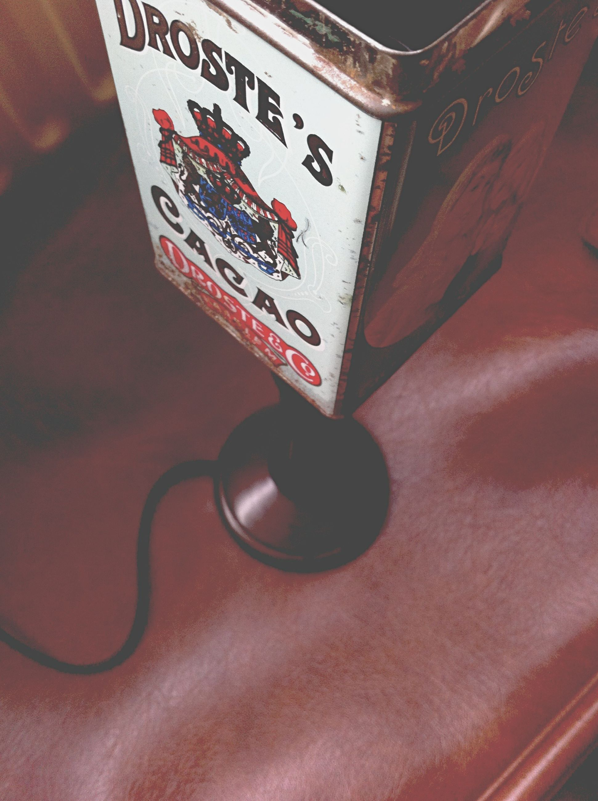 indoors, text, communication, western script, red, close-up, high angle view, technology, still life, number, no people, non-western script, information, table, capital letter, metal, wall - building feature, single object, music, connection