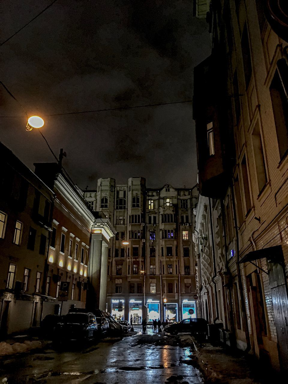 building exterior, architecture, built structure, car, motor vehicle, city, mode of transportation, illuminated, transportation, street, land vehicle, building, night, cloud - sky, residential district, no people, sky, street light, nature, outdoors
