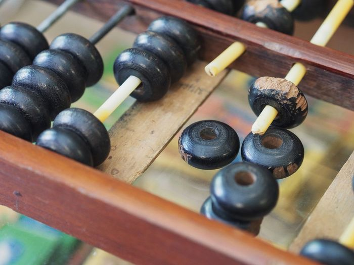 Close-up of broken abacus on table