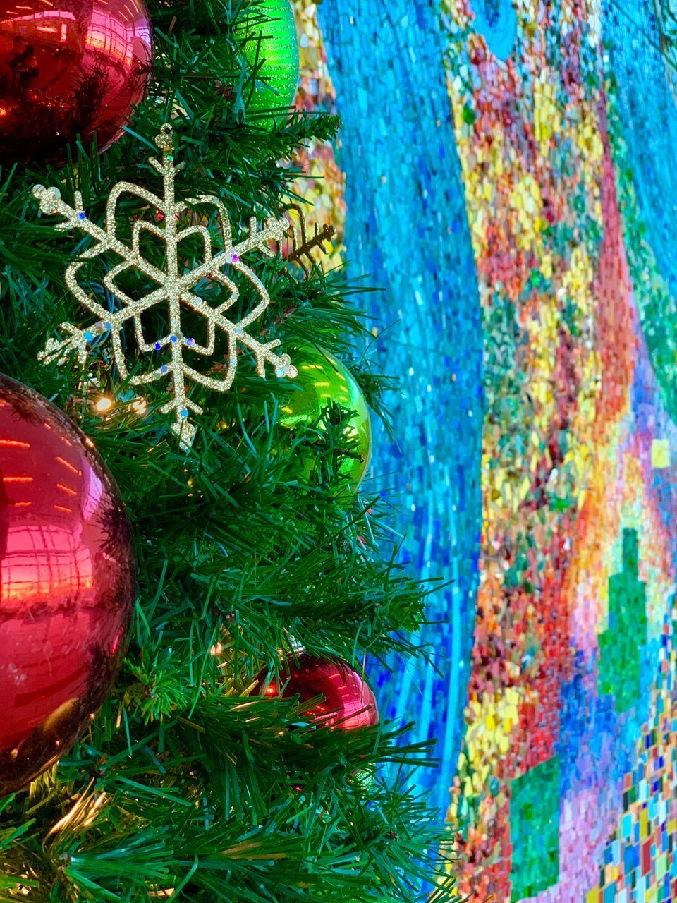 CLOSE-UP OF MULTI COLORED CHRISTMAS TREE AT HOME