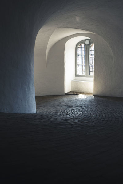 Copenhagen, Denmark Roundtower Absence Arcade Arch Arched Architecture Building Built Structure Copenhagen Day Direction Empty History Indoors  Light At The End Of The Tunnel Nature No People Rundetaarn Sunlight The Past The Way Forward Wall Wall - Building Feature Window