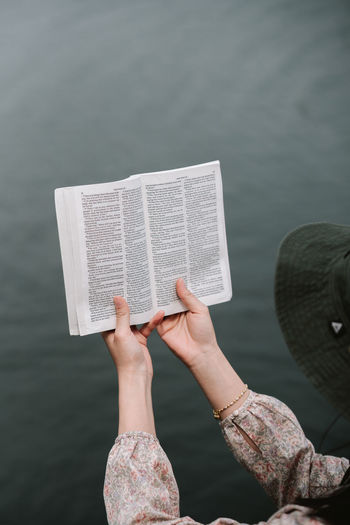 Low section of woman reading book