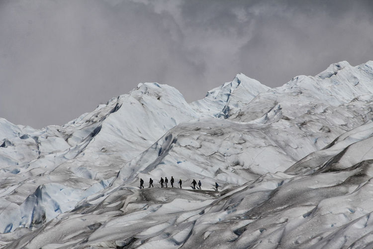 Glacier Cold Temperature Mountain Environment Snow Winter Landscape Sky Nature Beauty In Nature Ice Scenics - Nature Frozen Group Of People Mountain Range Non-urban Scene Snowcapped Mountain Cloud - Sky Tranquil Scene Outdoors Cold Formation Mountain Peak Trekking