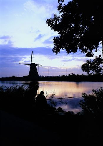 Mühlenmusem Rollfilm Repro Mittelformat Windmühle Beauty In Nature Cloud - Sky Day Diascan Holland Kinderdijk Lake Nature No People Outdoors Scenics Silhouette Sky Sunset Traditional Windmill Tree Water Wind Power Wind Turbine Windmill