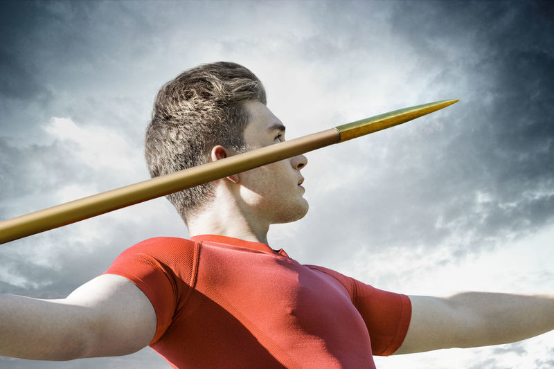 Attractive young man concentrates to throw his metallic javelin Athletics Man Olympic Stadium Attractive Competitive Sport Concentration Javelin Javelin Throw Spear Sports Strength Thrower Young Adult