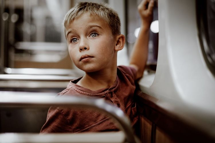 Thoughtful boy traveling in bus