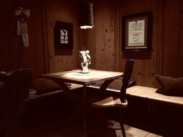 Alps Restaurant Interior Indoors  Table No People Seat Furniture Wood - Material Domestic Room Chair Absence Electric Lamp Vase Lighting Equipment Nature Home Interior Cosy Restaurant Alps Tirol  Traditional Comfortable Wooden Barrack Room Lounge Interior Views Alpine