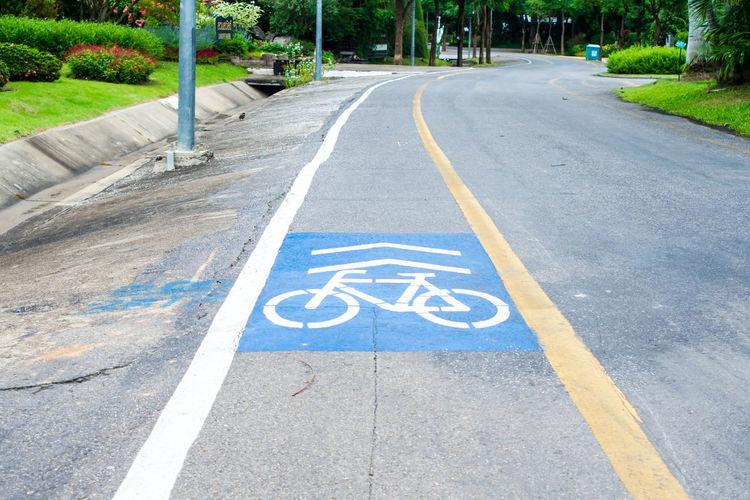 High angle view of markings on bicycle lane
