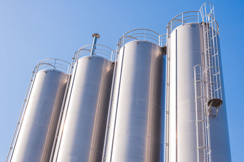 Storage tanks. Silos made in stainless steel. Chemical plant. Container Tanks Chemical Clear Sky Day Factory Factory Building Food And Drink Industry Industry Low Angle View No People Outdoors Petrochemical Plant Silo Sky Stainless Steel  Storage Compartment Storage Tank