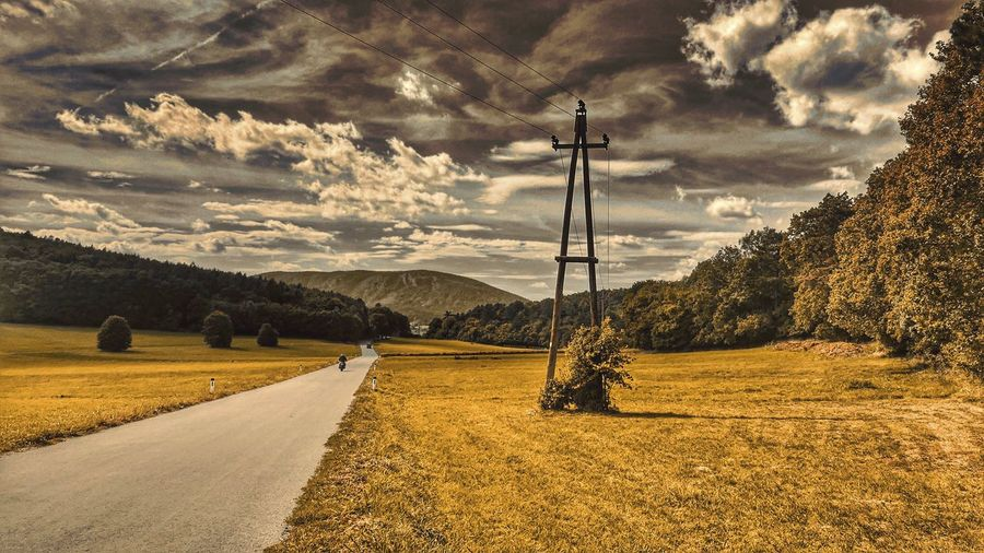 The Way Forward Countryside Mountain Country Road Tranquility Non-urban Scene Cloud Diminishing Perspective Global Photographer-Collection A Photo Like A Painting Cloudscape Austria Mystical Atmosphere Melancholic Landscapes Tranquil Scene Cloud - Sky Bicycle Trip Capture The Moment Landscape