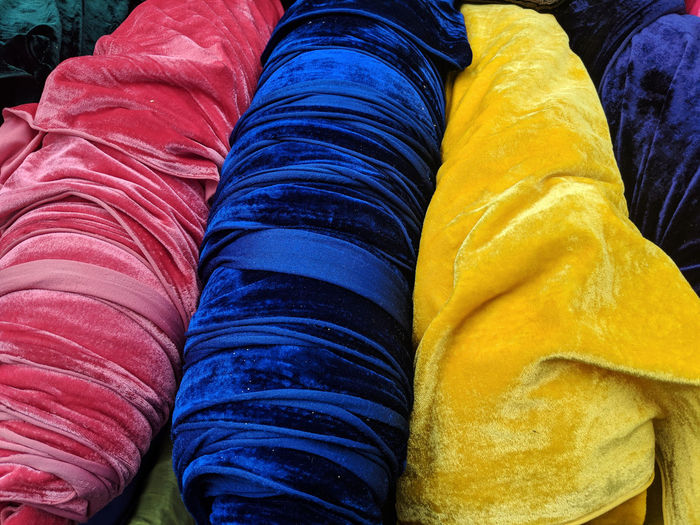 Soft touch in three colours Sewing Craft Handmade Homemade Supplies Soft Velvety Velvet Velour  Rolls Market Market Stall On A Roll Bright Saturated Touch Tactile Yellow Blue Multi Colored Textile Backgrounds Close-up Fabric Cloth Material Colorful Fiber