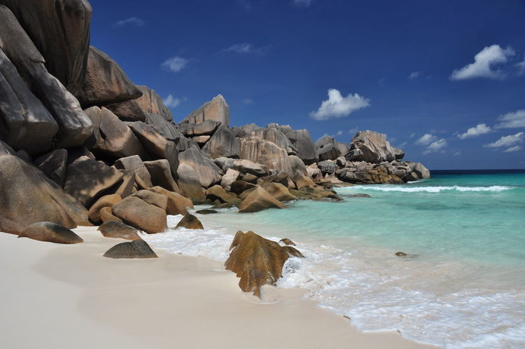 the most exquisite tranquil beach with very photogenic granite boulders Azureblue Coastline Ladigueisland Rock Sea Seychelles Shore WhiteSandBeach GrandeAnse The KIOMI Collection