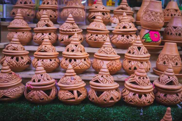 Art And Craft Craft Large Group Of Objects No People Pottery Creativity Earthenware For Sale Ceramics Choice Retail  Abundance Market Arrangement Collection In A Row Variation Day Pot Brown Outdoors Retail Display Antique