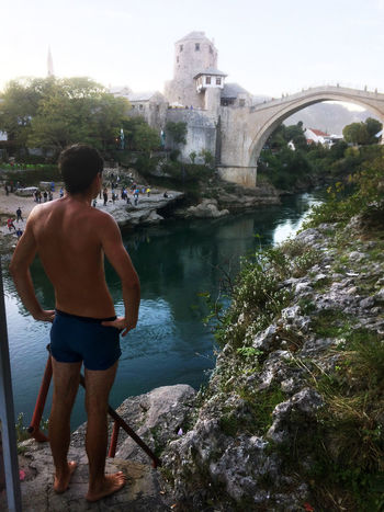 Architecture Balkan Mostar Mostar Bosnia Mostar Bridge Mostar ♥ Riverside Shirtless Vacations Admiring The View Balkans Bridge Bridge - Man Made Structure History IPhoneography Jumper Mobilephotography Neretva Neretva River One Person Real People River Standing Travel Destinations View From Above