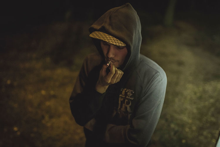 Canifoul Production Hip Hop Profik Bad Habit Casual Clothing Close-up Focus On Foreground Lifestyles Night One Person Outdoors People Real People Warm Clothing