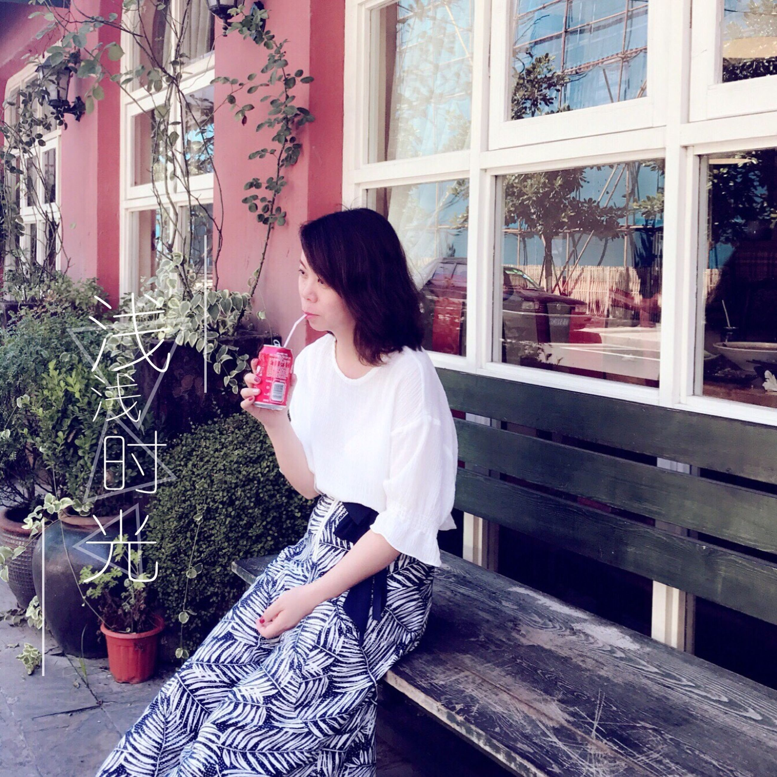 real people, one person, casual clothing, window, leisure activity, lifestyles, sitting, day, young adult, young women, indoors, full length, standing, building exterior, tree, architecture