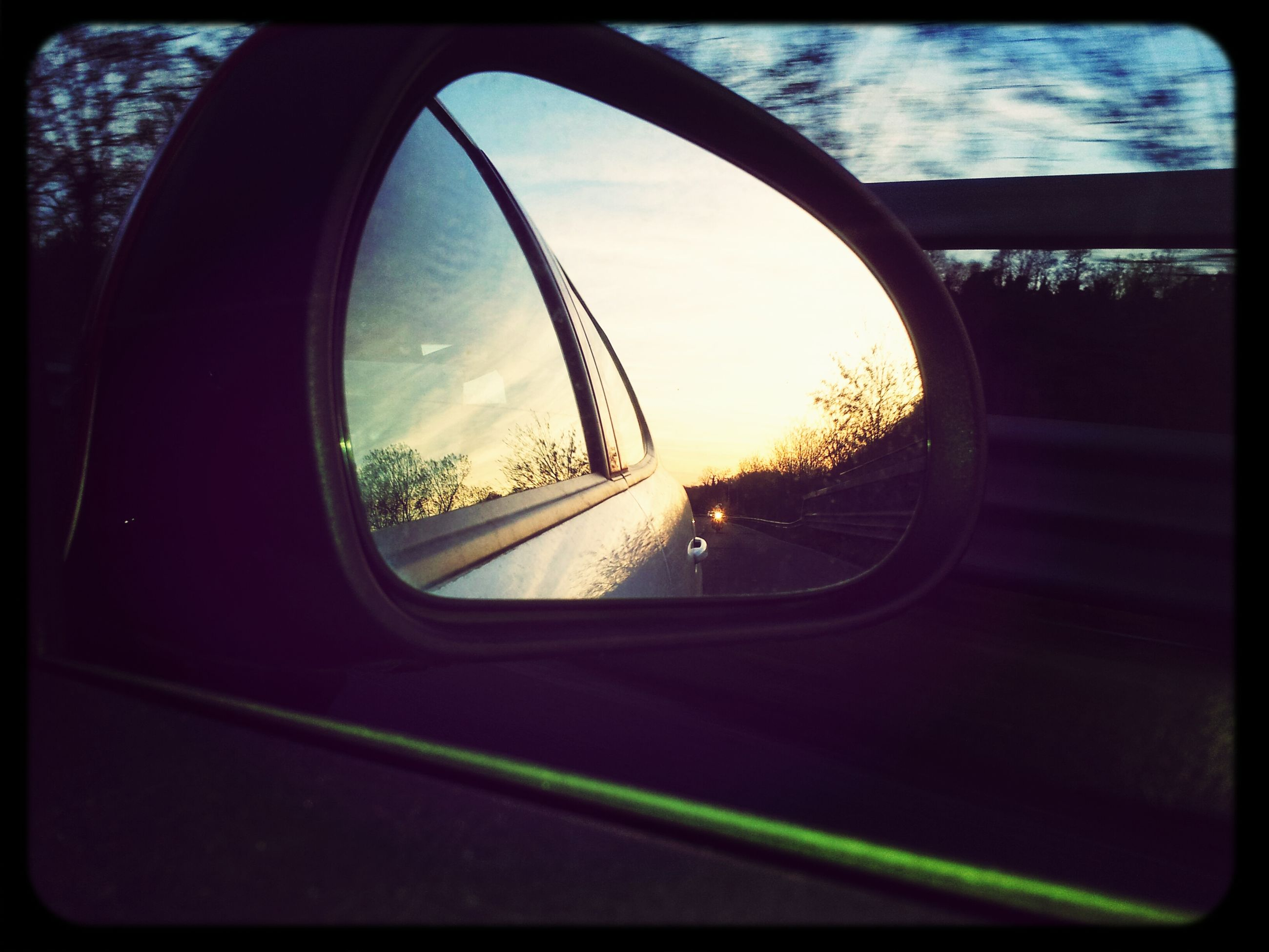 transportation, land vehicle, car, side-view mirror, mode of transport, sky, reflection, glass - material, transparent, road, sunset, window, transfer print, sun, car interior, street, vehicle interior, cloud - sky, close-up, sunlight