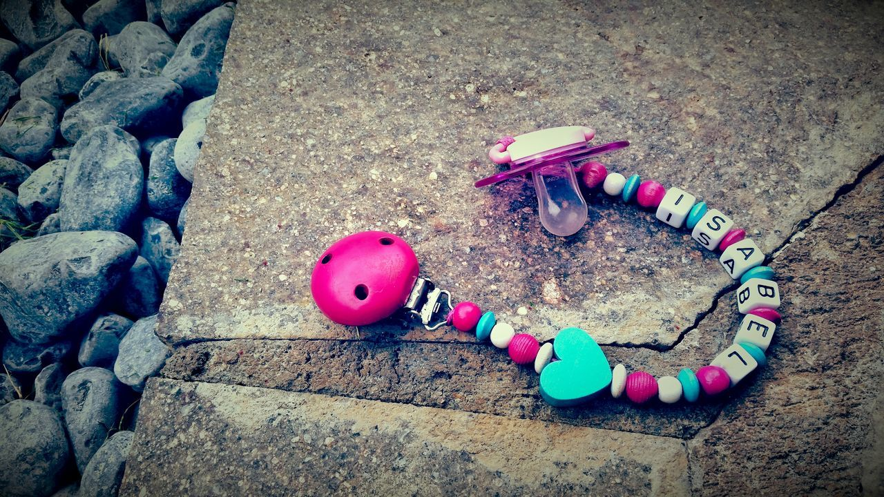 High Angle View Of Abandoned Pacifier On Footpath